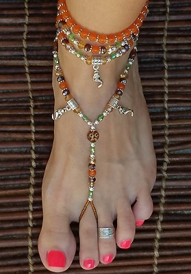 Barefoot sandals with mermaids charms dangle under happy glass moon beads