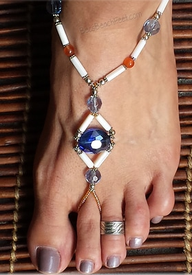 Caribbean sailing foot jewelry with a large, blue crystal surrounded by white mother-of-pearl, south African orange topaz, glass and silver plated beads