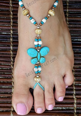Foot jewelry with turquoise howlite butterfly focal bead, surrounded by wood, bone and silver plated beads