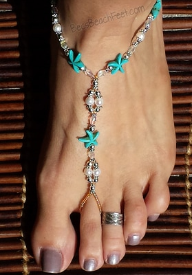 Barefoot sandals crafted with vibrant caribbean blue starfish harmonizing with white, Swarovski® crystal pearls beads.