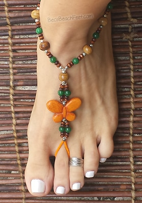 Foot jewelry with central orange, howlite butterfly with dark green and small brown beads