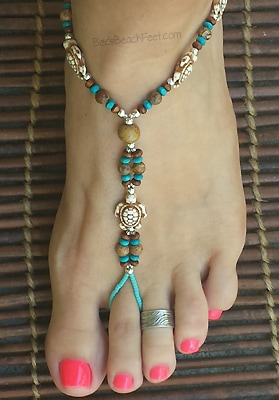 Sea Turtle Foot Jewelry crafted with the howlite turtles surrounded by wood, jasper, bone & silver plated beads.