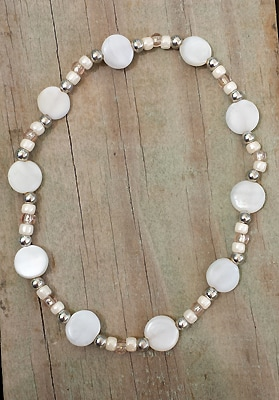 anklet with white luminous mother-of-pearl coin beads